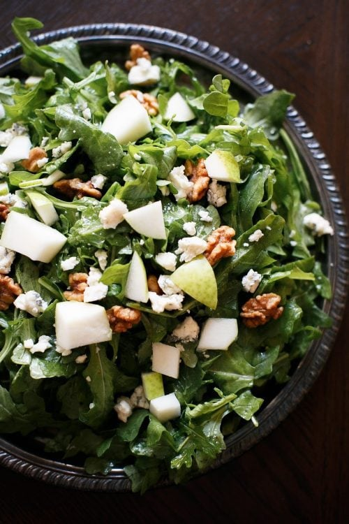 pear and walnut salad with gorgonzola on a silver platter