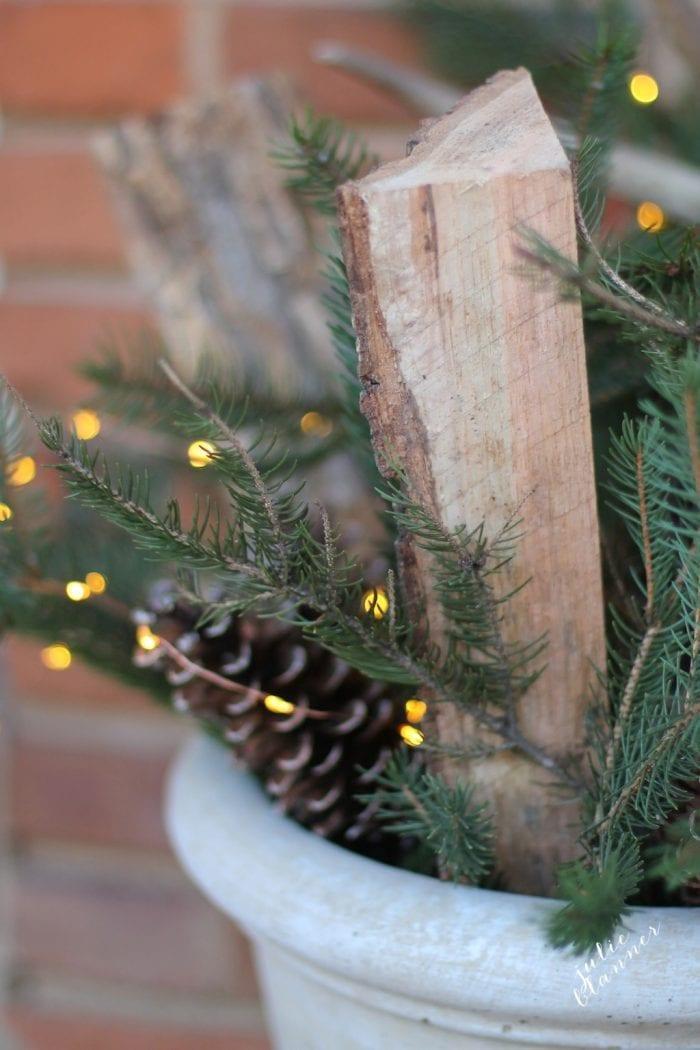 Twinkle lights make the outdoor arrangement festive for Christmas