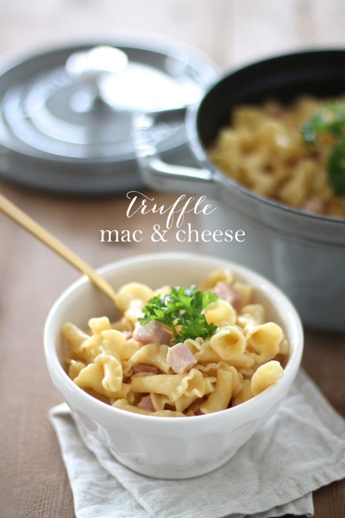 truffle mac and cheese in a white bowl with gold spoon and text overlay
