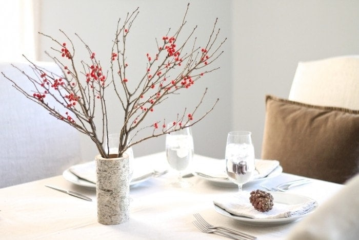 A simple winter table setting with berries & birch