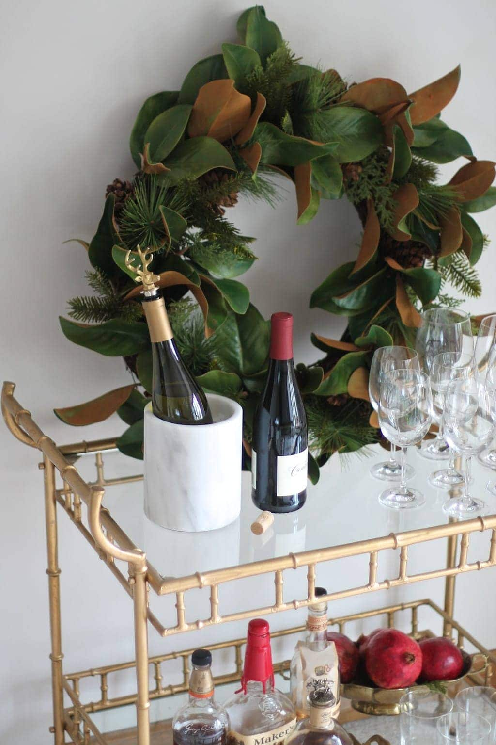 Beautiful brass bar cart styled for effortless Christmas entertaining with a magnolia wreath