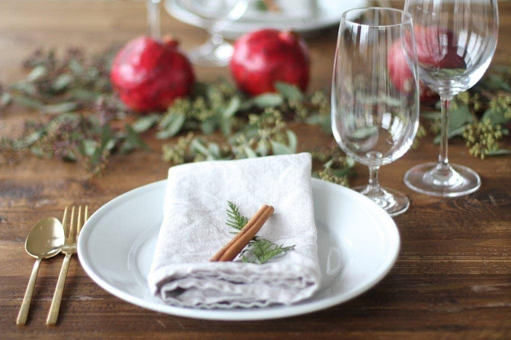 Casual & cozy pomegranate Christmas table setting