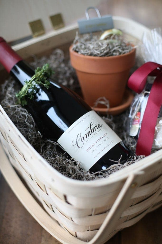 Gorgeous gift basket filled with wine and chocolate with a molten lava cake mix, potted paperwhites and more.