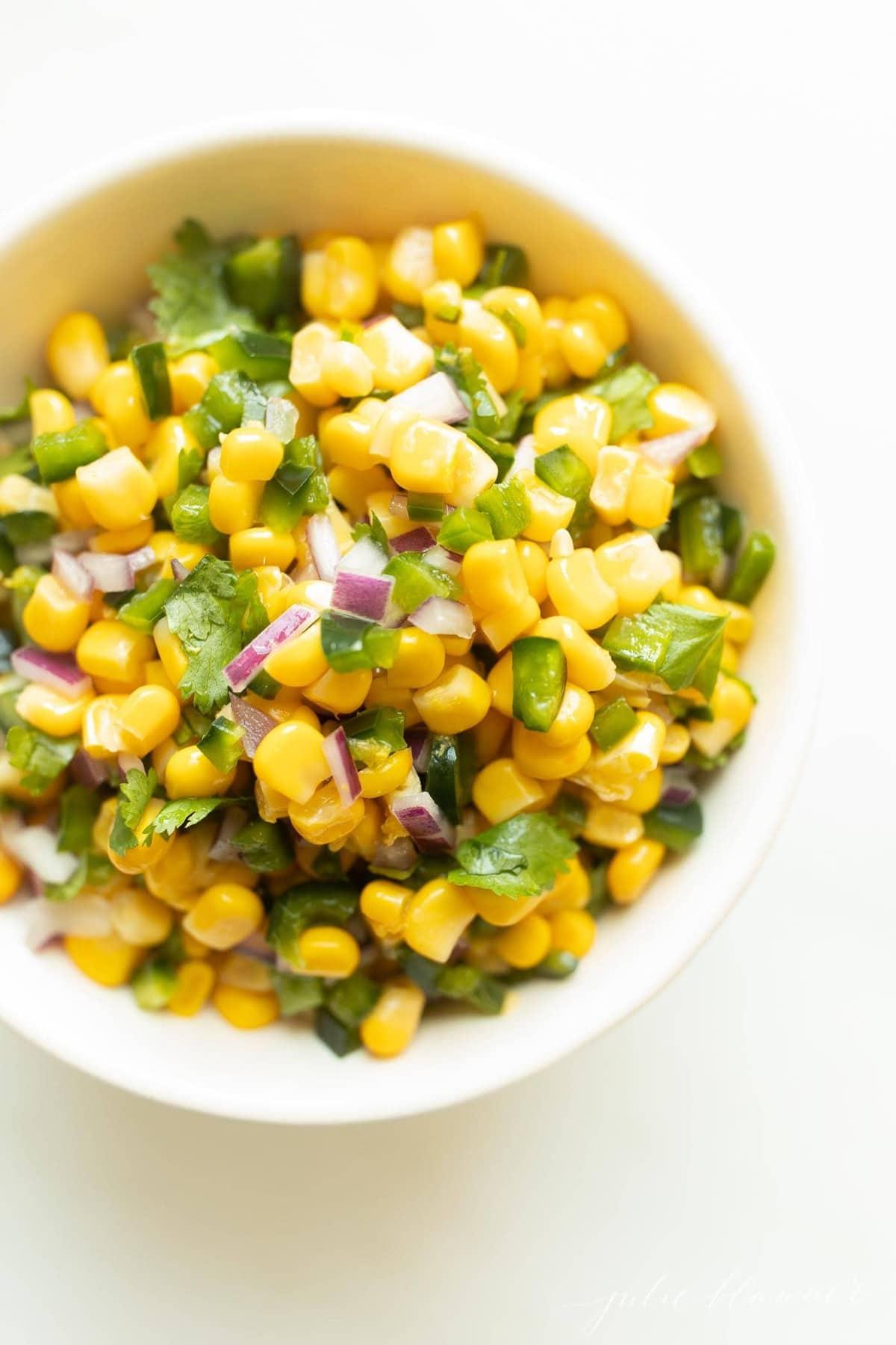 Chipotle corn salsa in a white bowl.