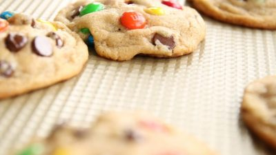 M and M cookies on a cooling rack.