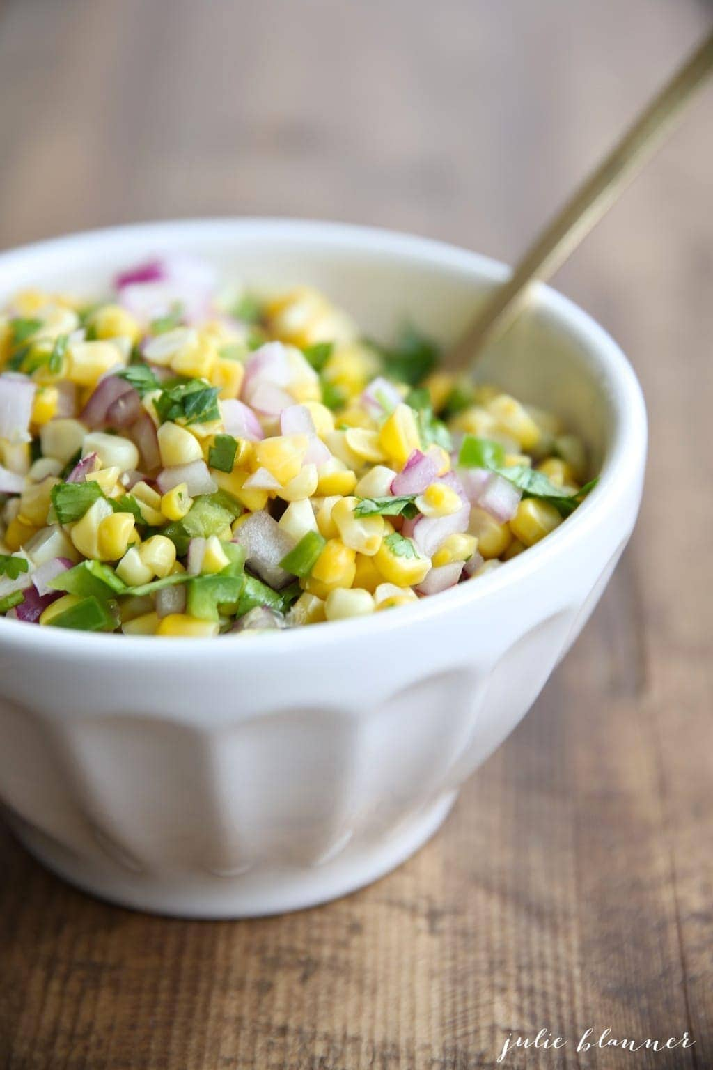 This Chipotle Corn Salsa Recipe is a fresh and easy dip or topping for tacos, quesadillas, burritos and more! Add this Chipotle Corn Salsa to your burrito bowls for the ultimate Chipotle copycat. #chipotle #cornsalsarecipe #chipotlecornsalsa
