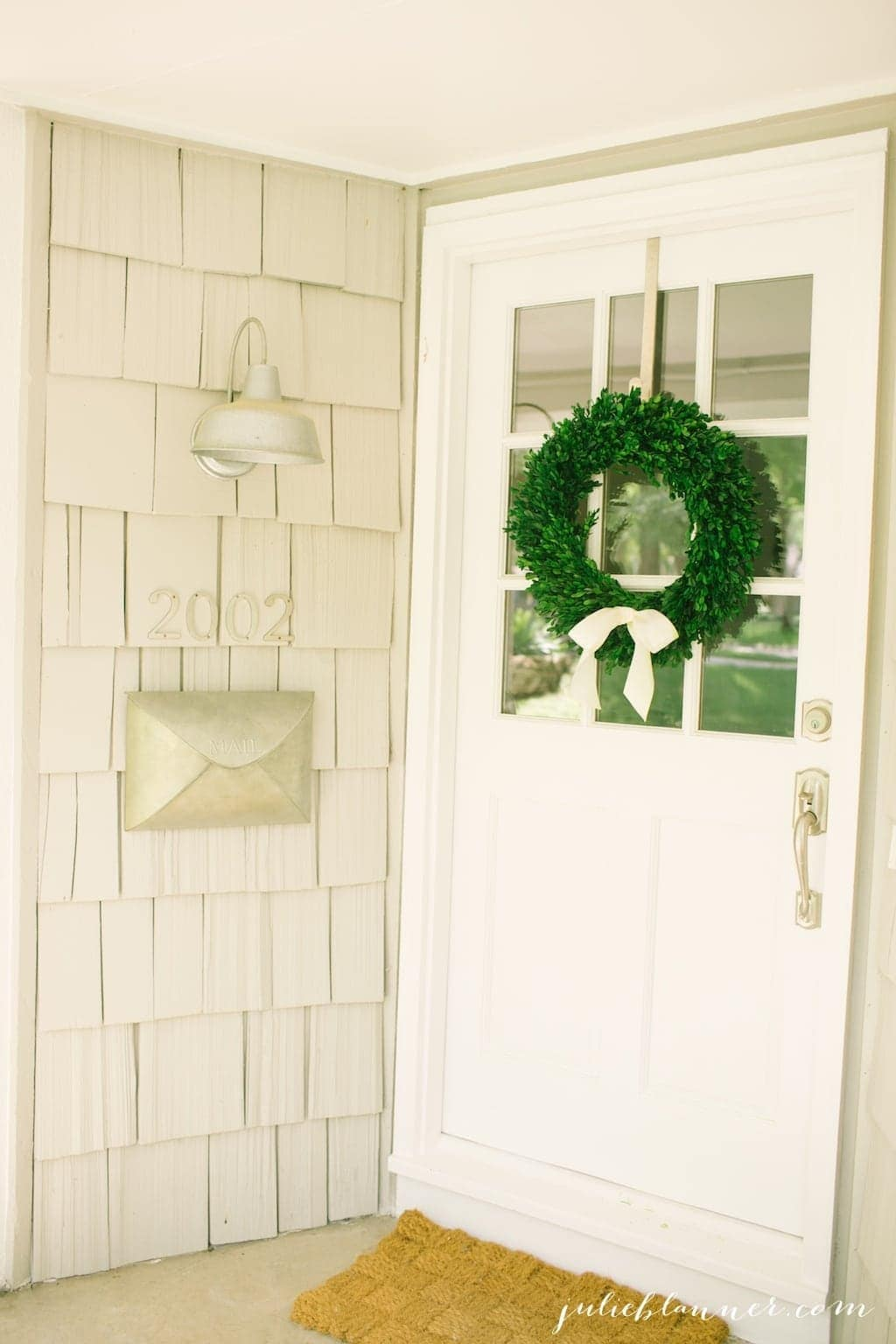 Gorgeous front porch with envelope mailbox, cottage lighting & a front door with windows