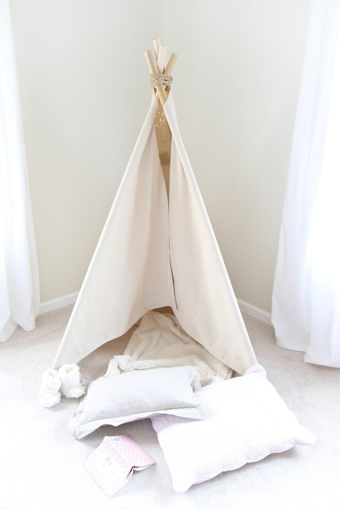 How to Make a Teepee | 1 hour easy no sew teepee tutorial. Get the easy DIY details of this wigwam play tent that's a fun addition for a bedroom or playroom!
