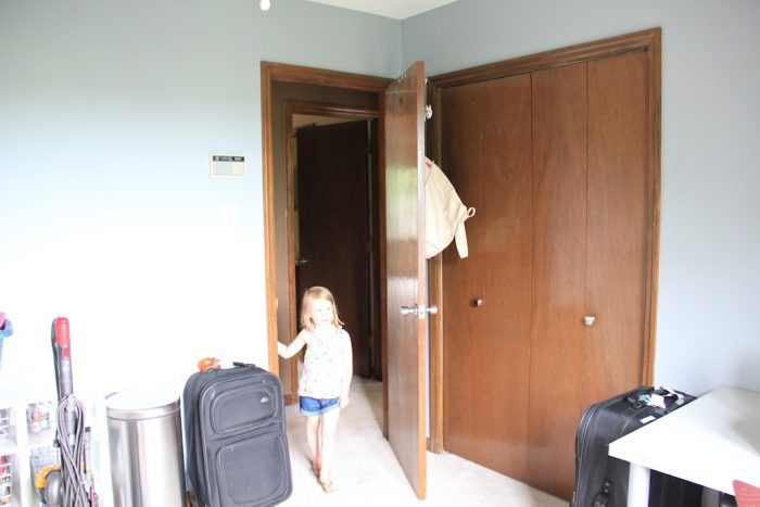 girl in room with dated doors