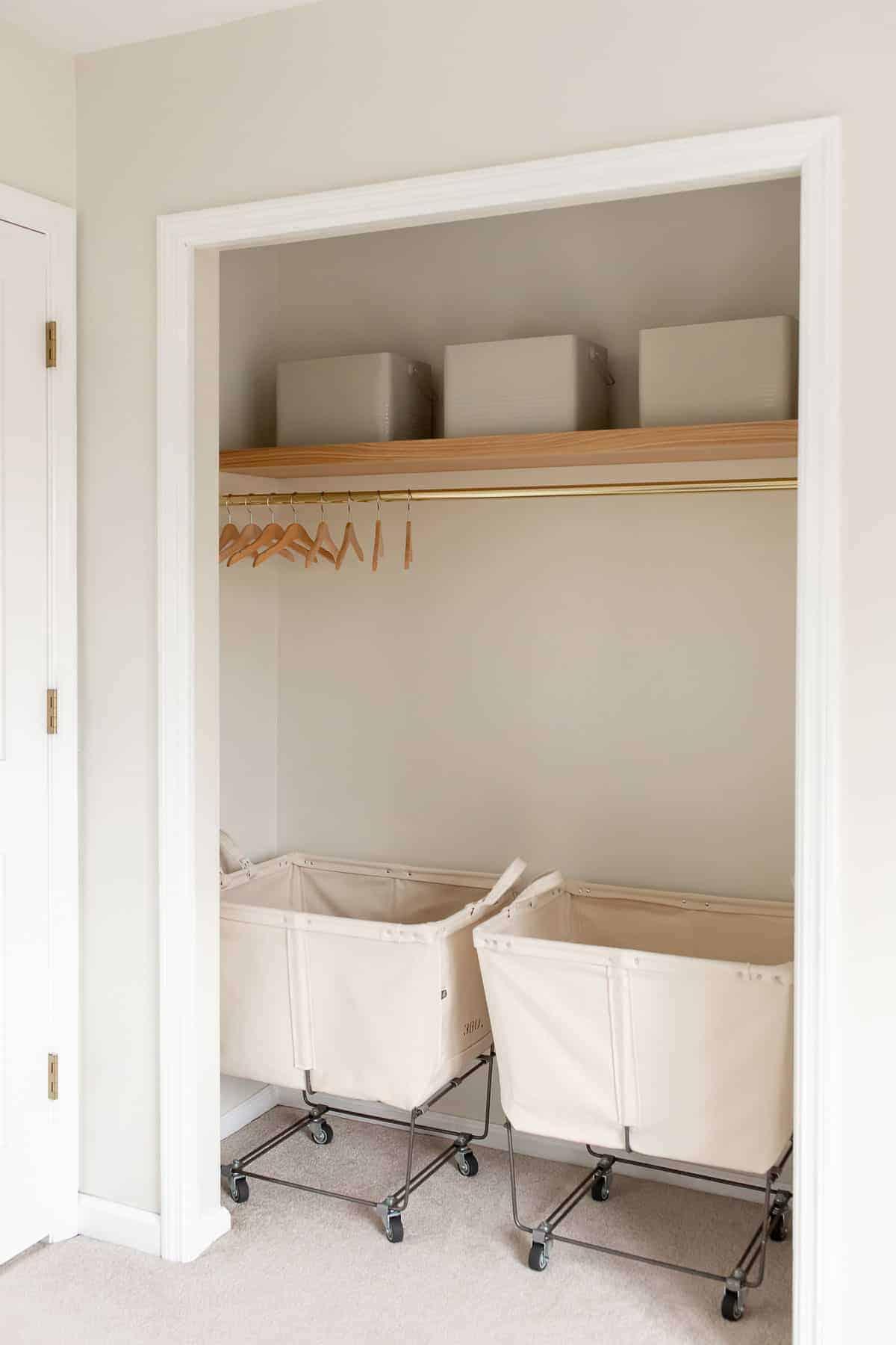 laundry closet with floating shelf and 2 laundry carts