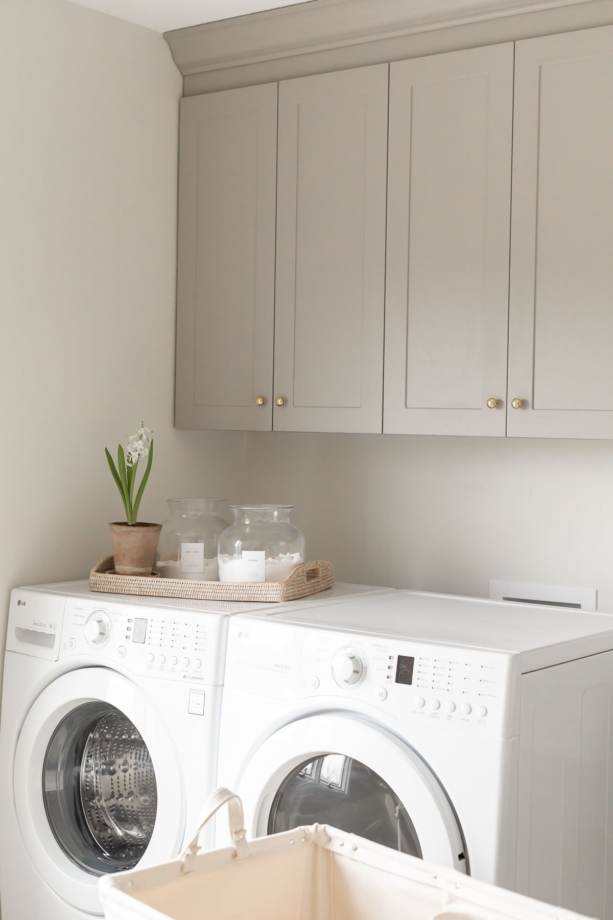laundry rom cabinets above washer and drywer
