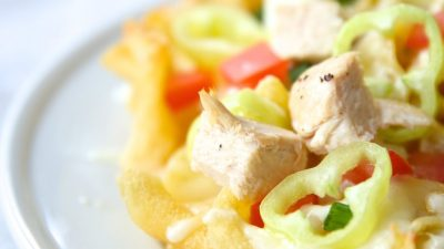 Easy Italian nachos recipe with juicy chicken & amazing asiago cream sauce!