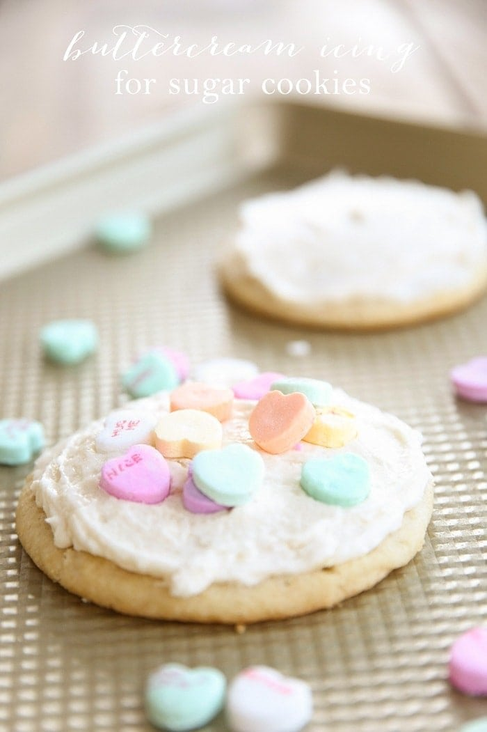 A sugar cookie with buttercream frosting and sprinkles