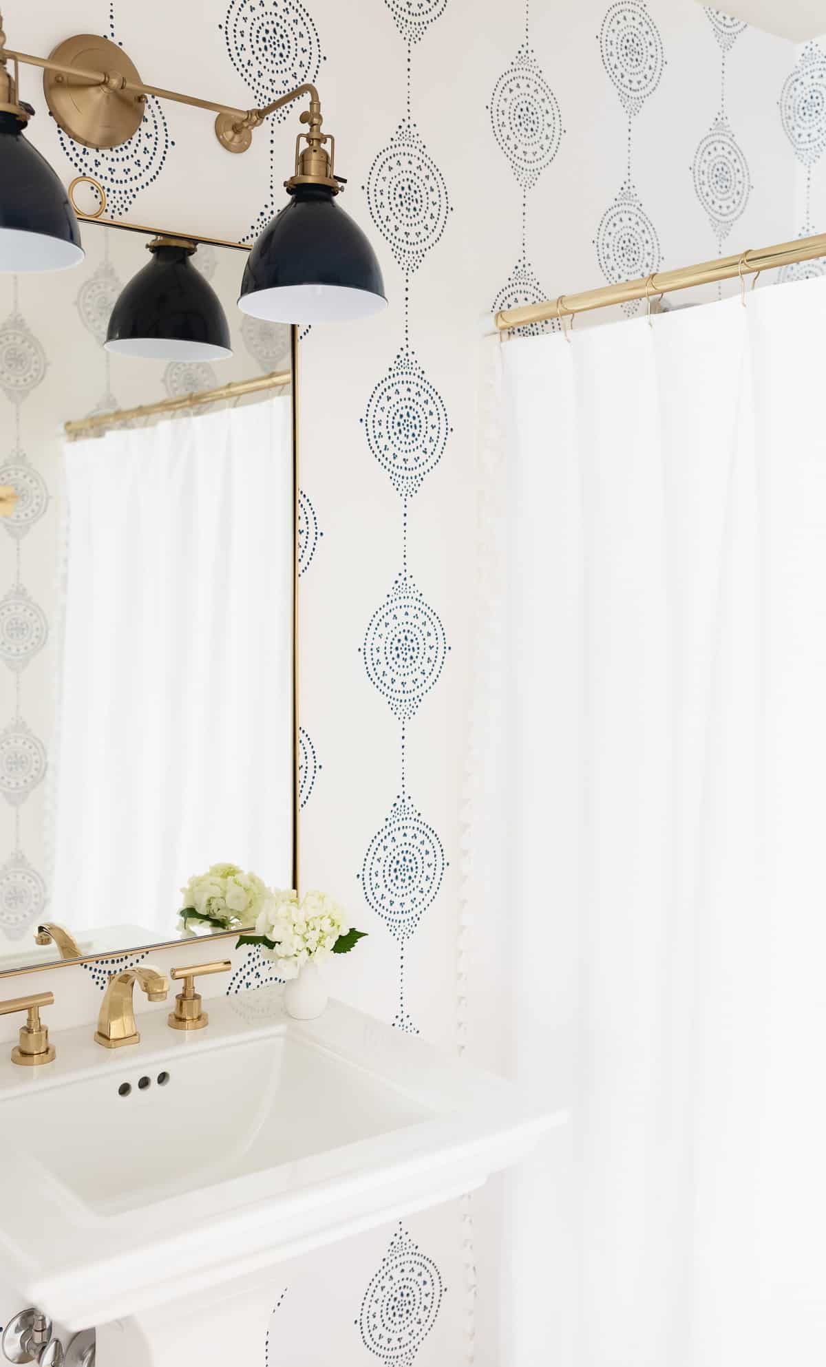 double wall light on bathroom mirror and sink