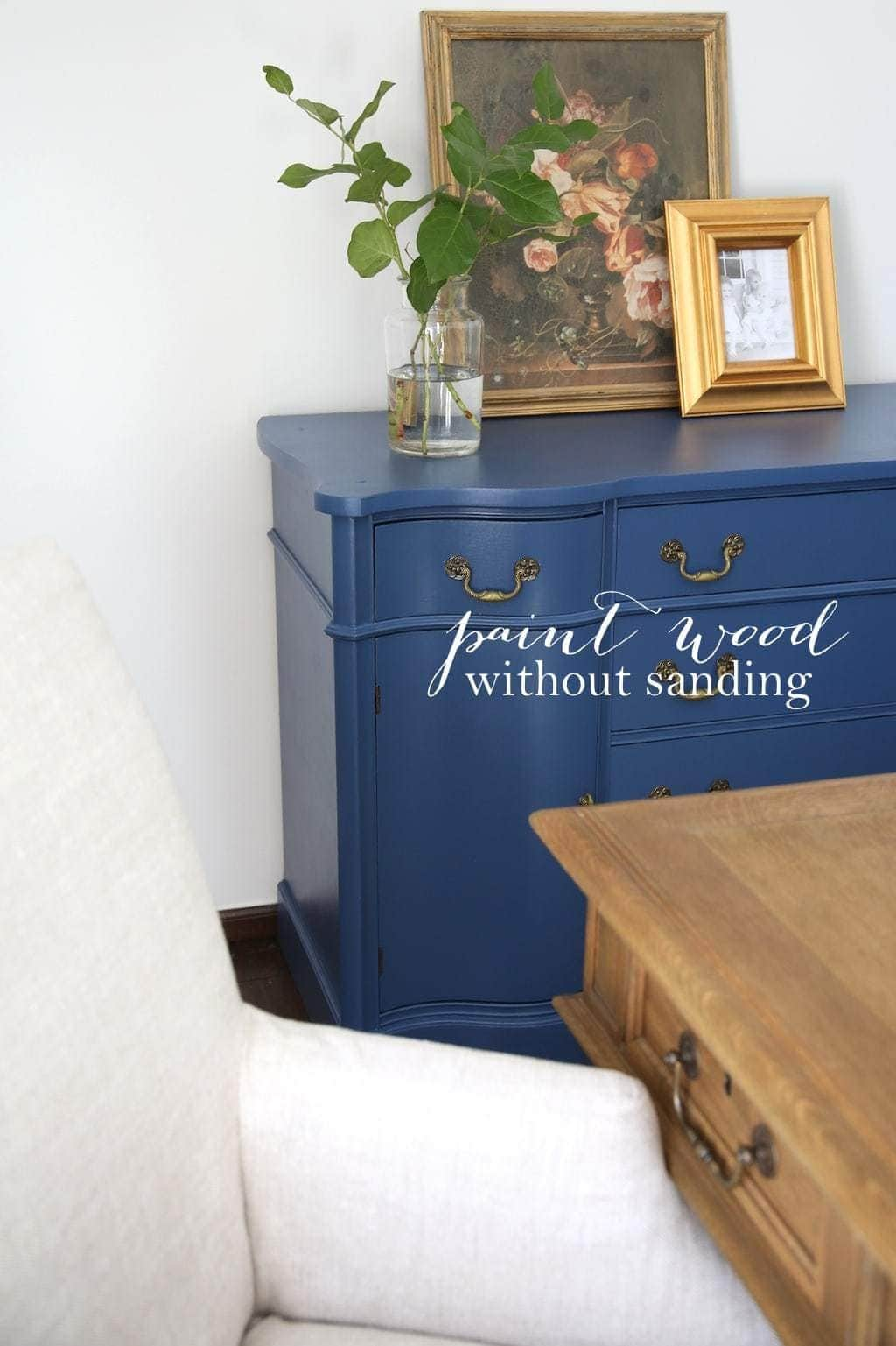 blue buffet painted over stained wood with liquid sandpaper
