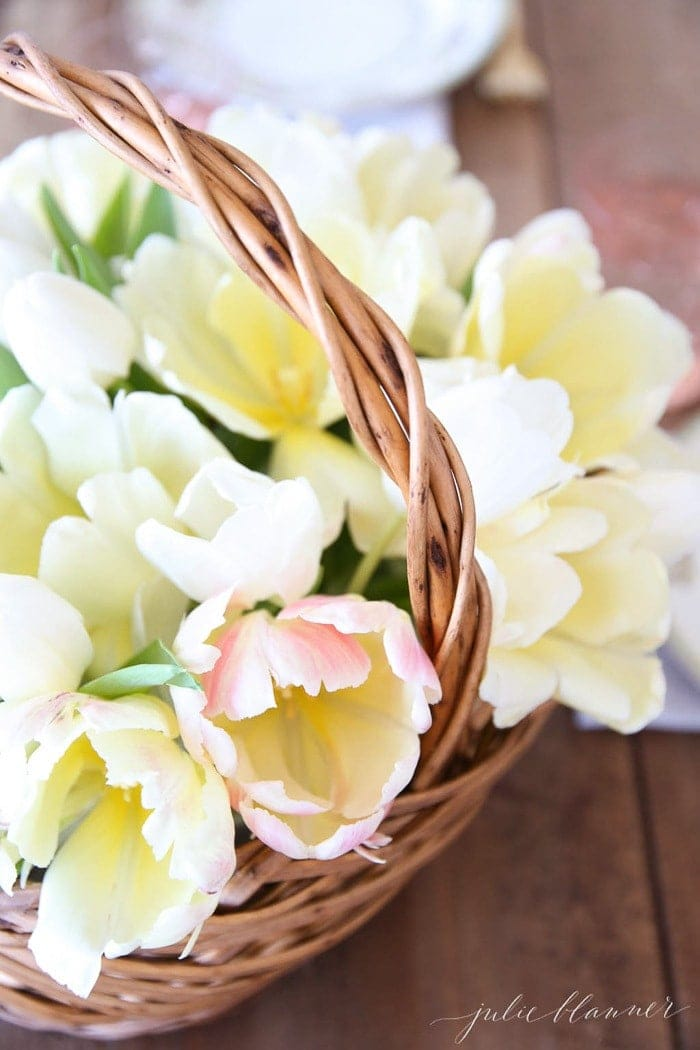 flower basket filled with fresh yellow tulips
