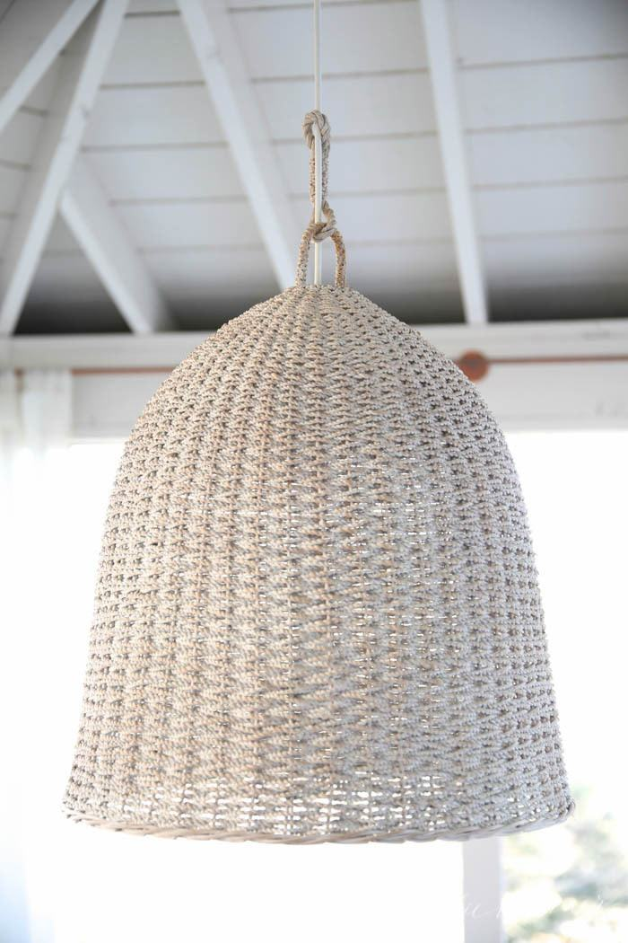 This outdoor pendant light fixture was created from a basket & a light kit for an inexpensive, but beautiful fixture