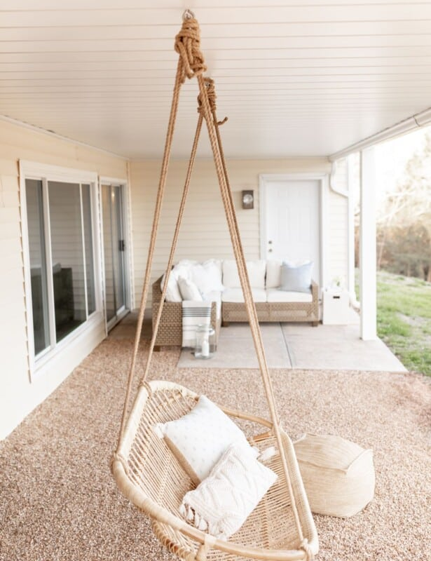 An outdoor room with a white under deck ceiling.