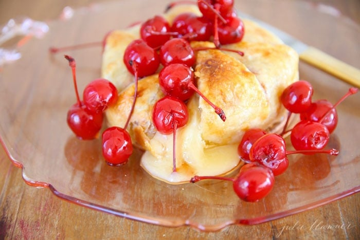 Balsamic soaked cherries are the perfect compliment to buttery baked brie in this easy 10 minute appetizer!