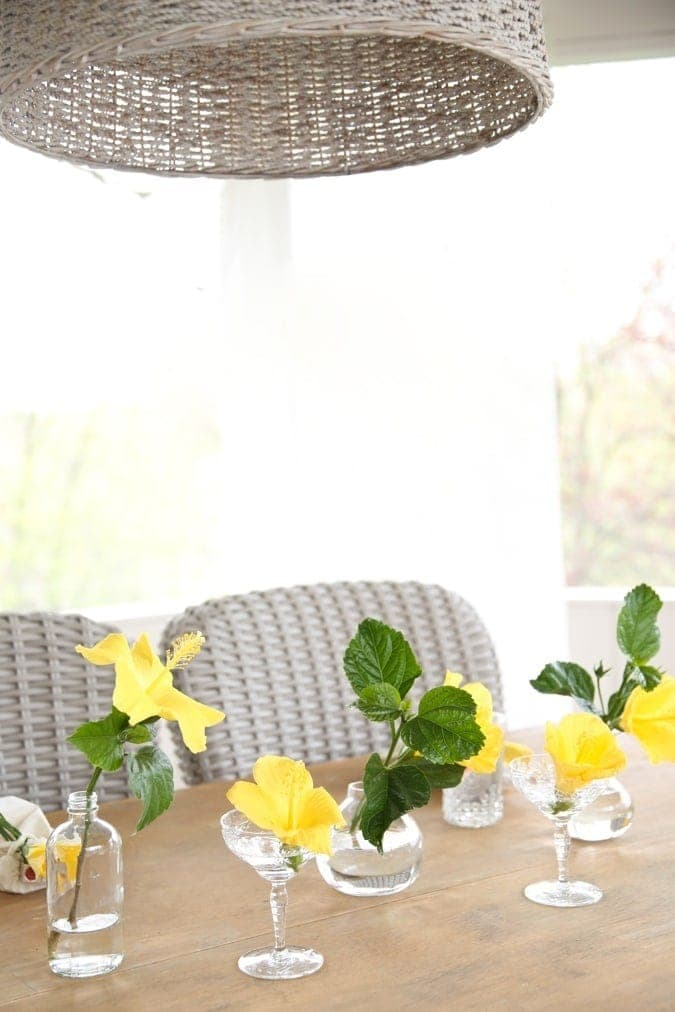 Easy flower arrangement using a collection of glassware