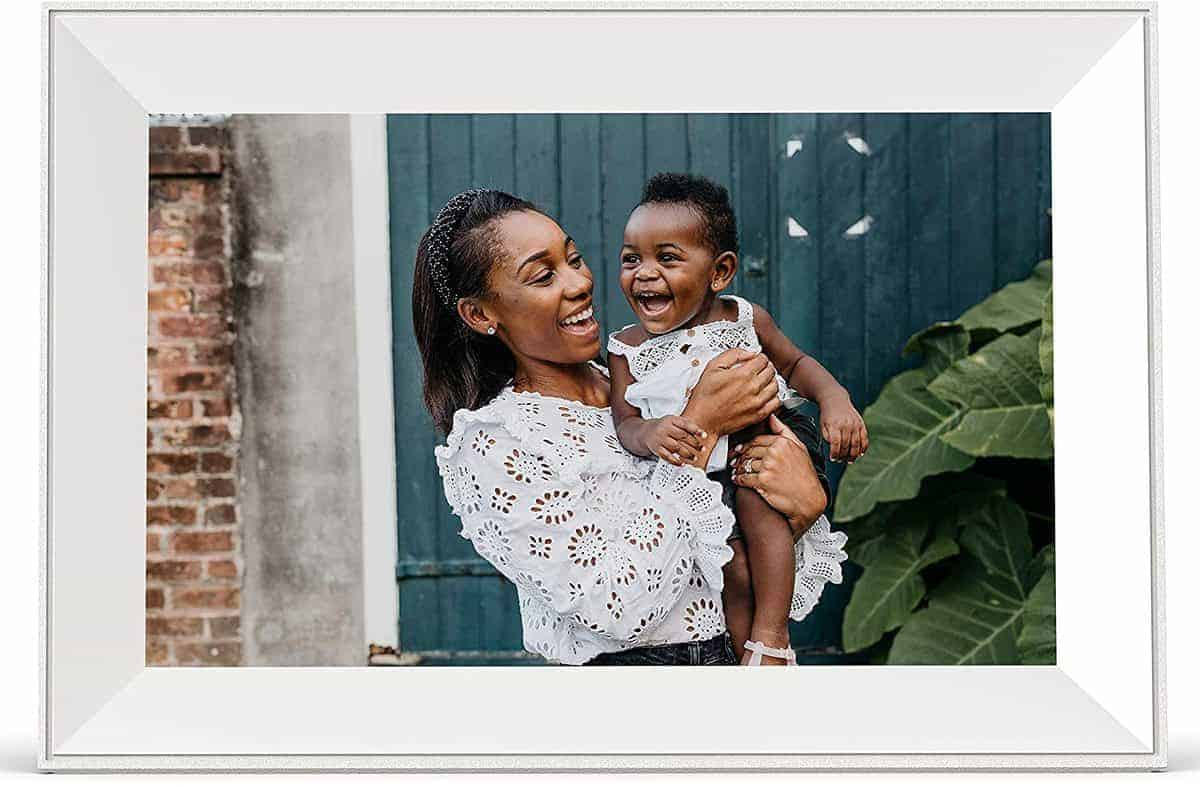A digital photo frame featuring a stock image of mother and child.