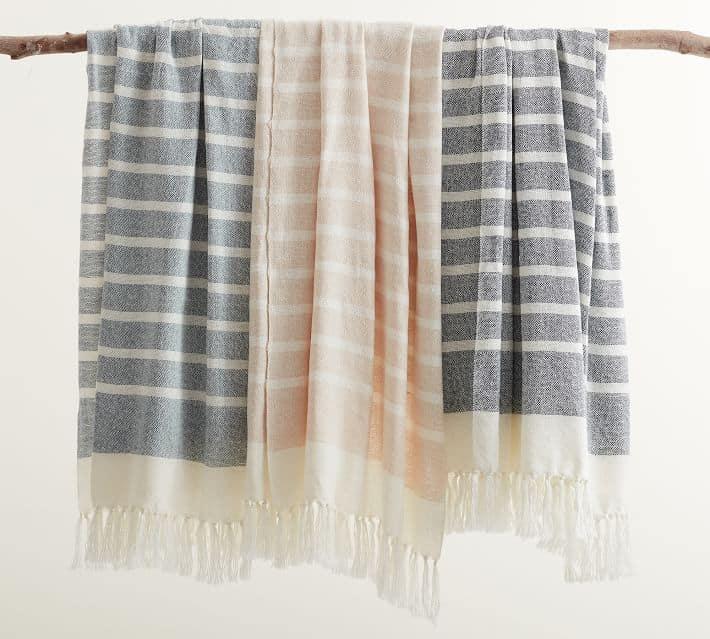 Three striped indoor outdoor blankets.