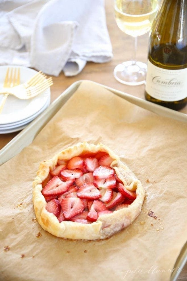 The baked strawberry tart on a baking sheet
