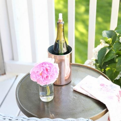 DIY Wine Bottle Tiki Torch | Add ambience while deterring bugs this summer with a tiki torch made from a wine bottle in less than 10 minutes!