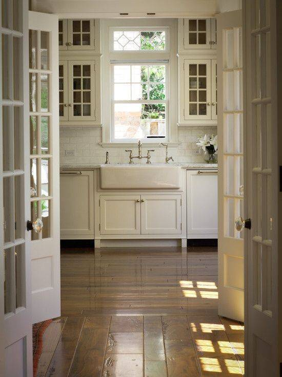 Update doors with french doors to allow more light in the laundry room or mudroom while still creating an inviting space