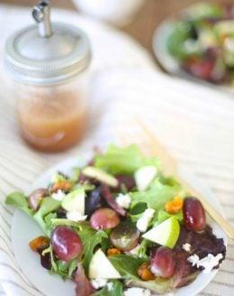 healthy raspberry vinaigrette in mason jar with salad