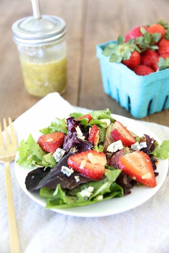 Strawberry salad with poppy seed dressing served with a fork