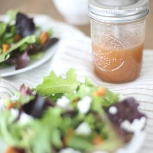 raspberry vinaigrette in mason jar with salad with text overlay
