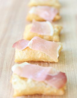 gnocco fritto topped with olive oil, prosciutto, and sea salt