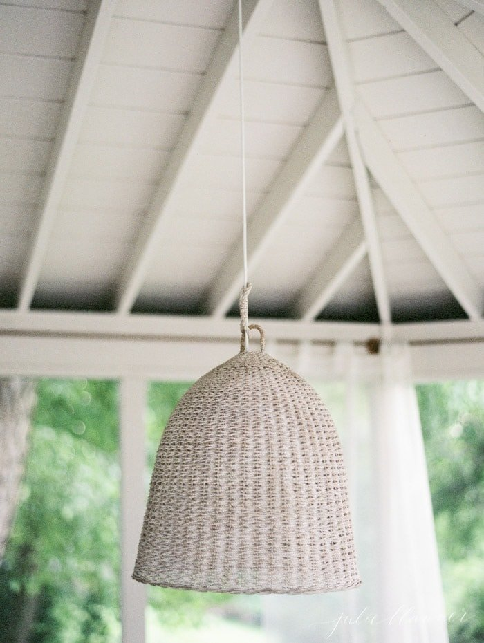 A screened in porch hanging light fixture.
