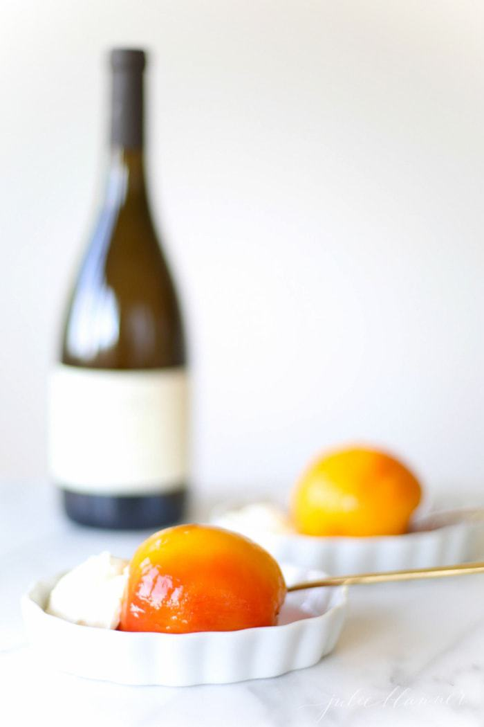 mascarpone cream served with poached peaches on white plates