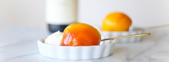 Mascarpone cream served with a poached peach in a white bowl