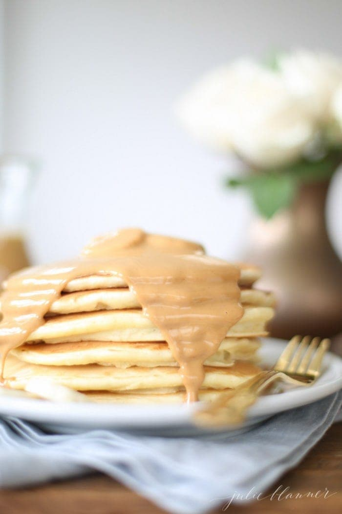 Classic pancakes covered in peanut butter syrup