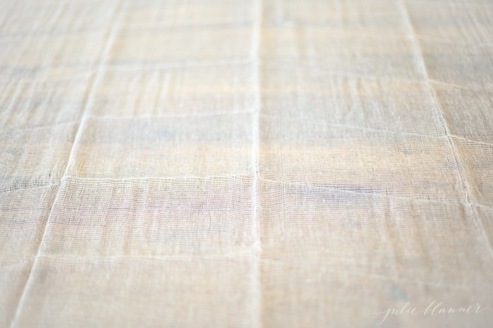 Inexpensive cheesecloth makes a beautiful tablecloth and sets a soft tone