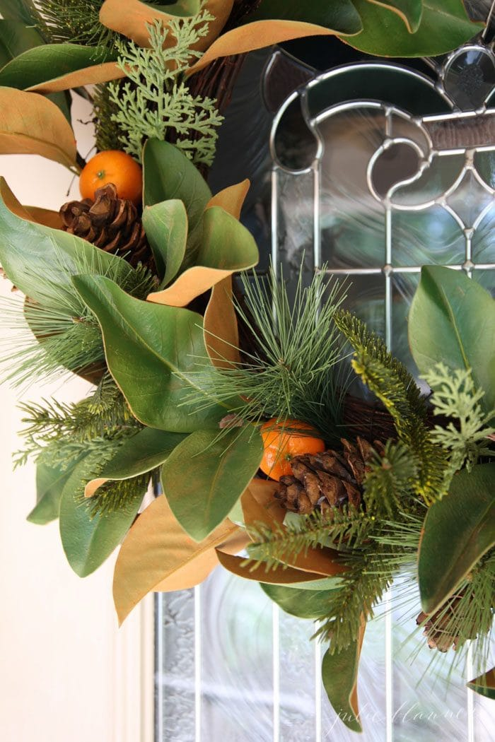 add color to a faux wreath by adding fresh fruits or berries