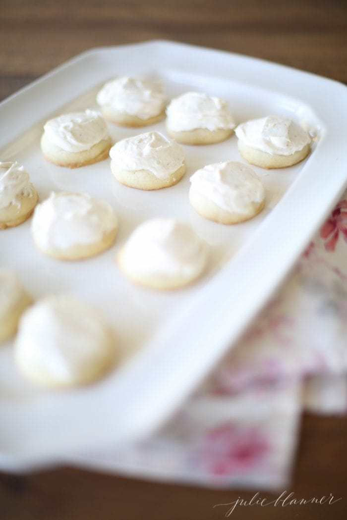 brown butter sugar cookies with brown butter frosting on a white serving plate
