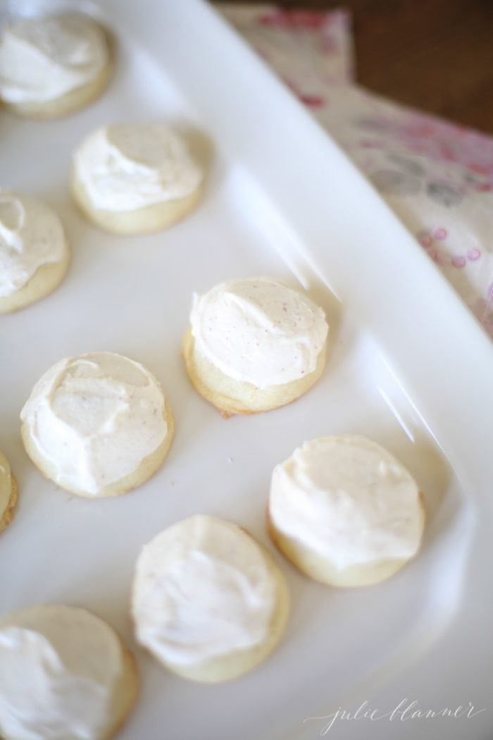 brown butter frosting on top of cookies