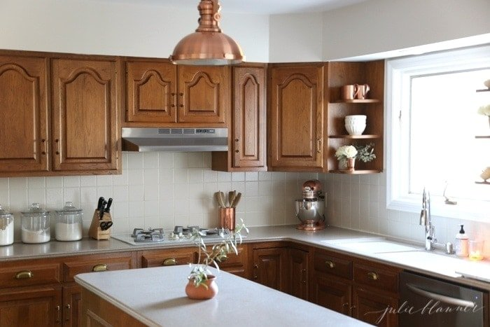 A simple kitchen makeover without paint for How can i update my kitchen cabinets on a budget