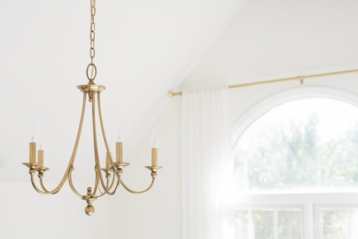 beautiful bedroom makeover with lots of tips | brass chandelier