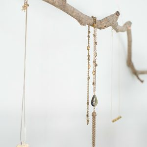 A jewelry hanger is a beautiful way to display your necklaces and bracelets and makes a great gift. Create your own in just 10 minutes for $5!