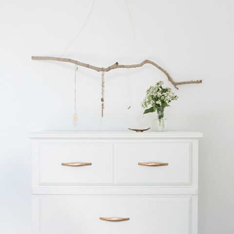 jewelry hanger over chest of drawers