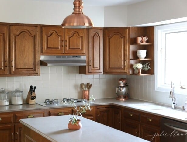An oak kitchen updated with paint colors that go with oak cabinets.