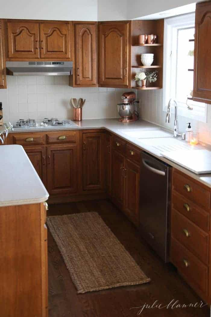 An oak kitchen updated with white kitchen paint looks fresh and modern.