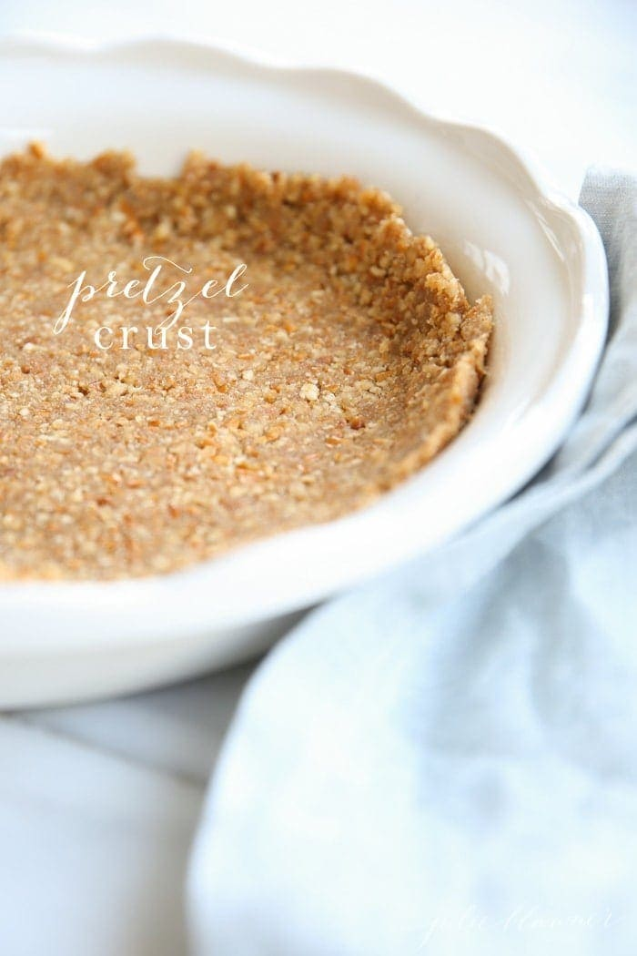 Pretzel crust in a white dish with text overlay