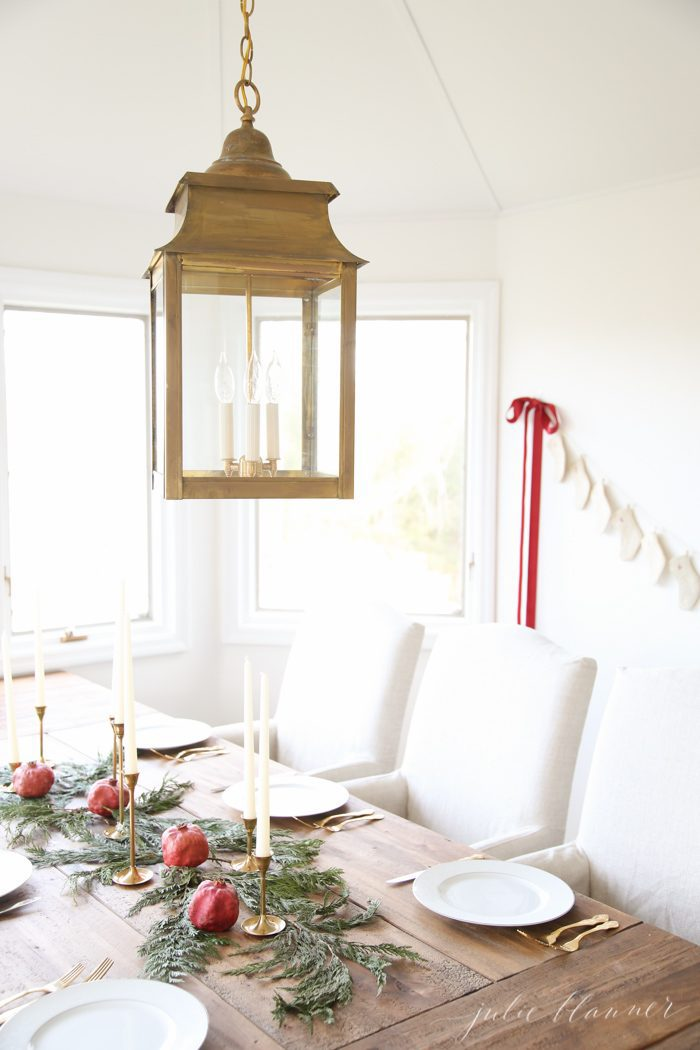 simple christmas table setting with gold lantern