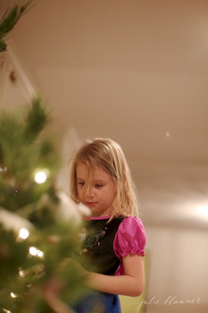 girl-decorating-christmas-tree
